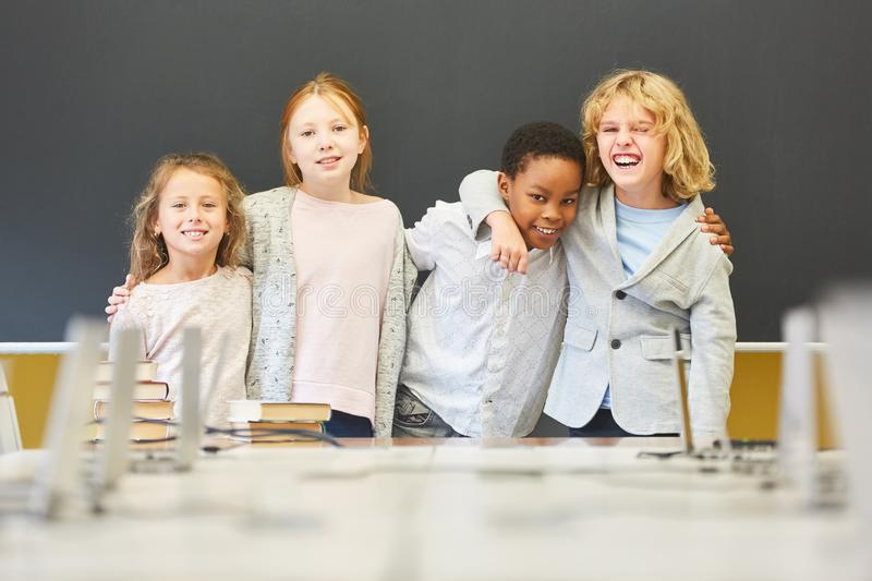 Four children as friends in elementary school royalty free stock photography