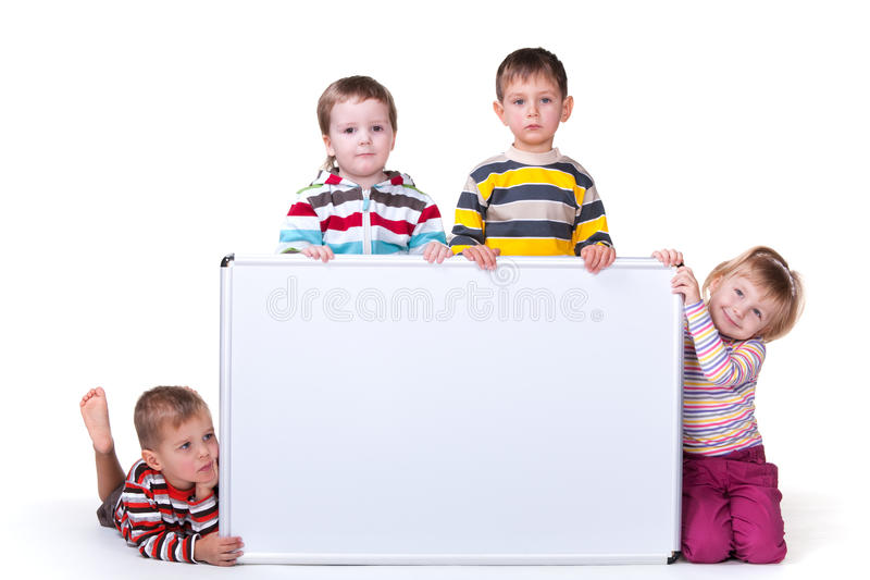 Download Four Children Holding A White Board Stock Photo - Image: 17883276
