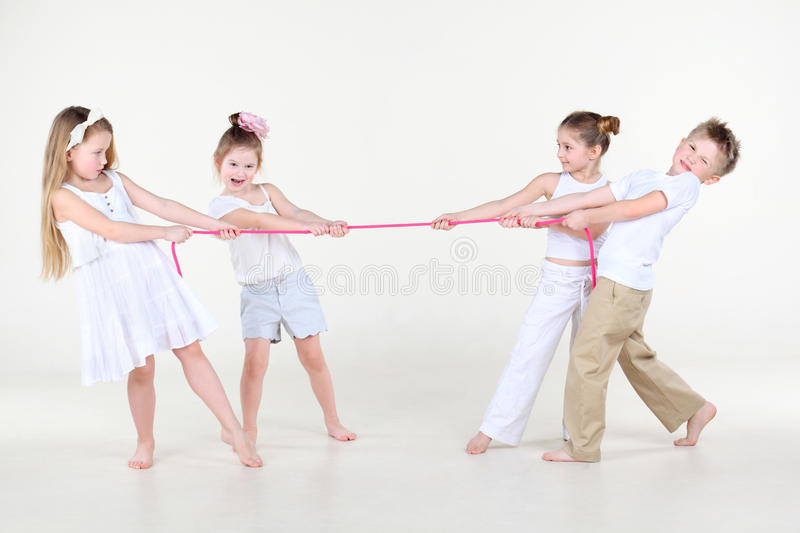 Download Four Children In White Clothes Overtighten Pink Rope Stock Image - Image: 29268863
