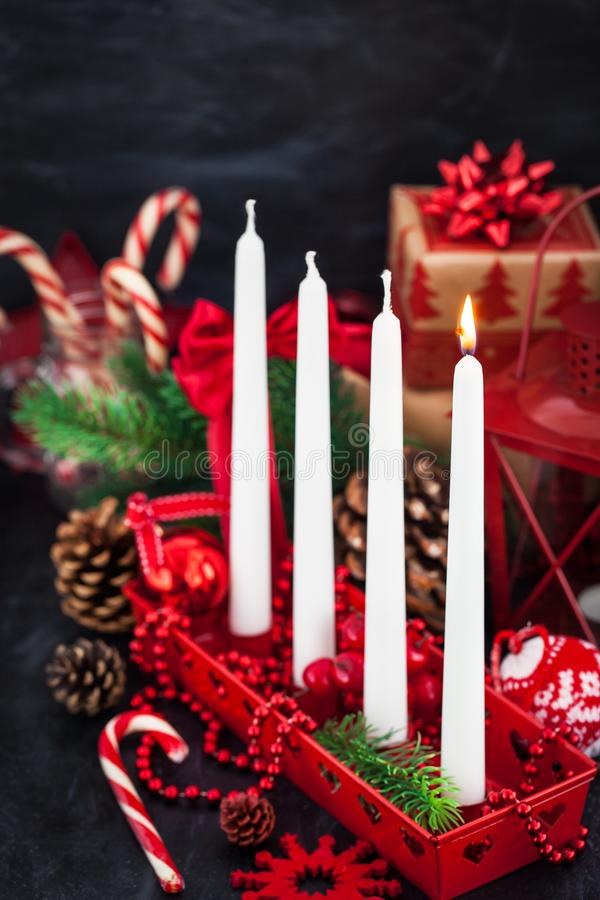 Four Christmas Advent candles and holiday decorations around on royalty free stock photos