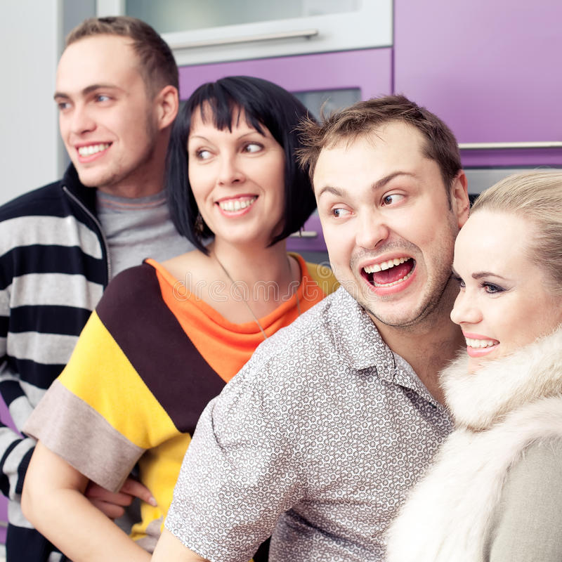 Four close friends enjoying a social gathering together stock photography