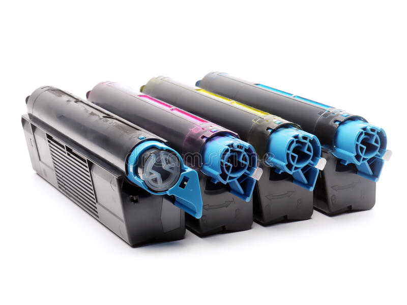 Four color laser printer toner cartridges. Four used laser printer toner cartridges of Cyan, Magenta, Yellow and black color shot over white background royalty free stock photo