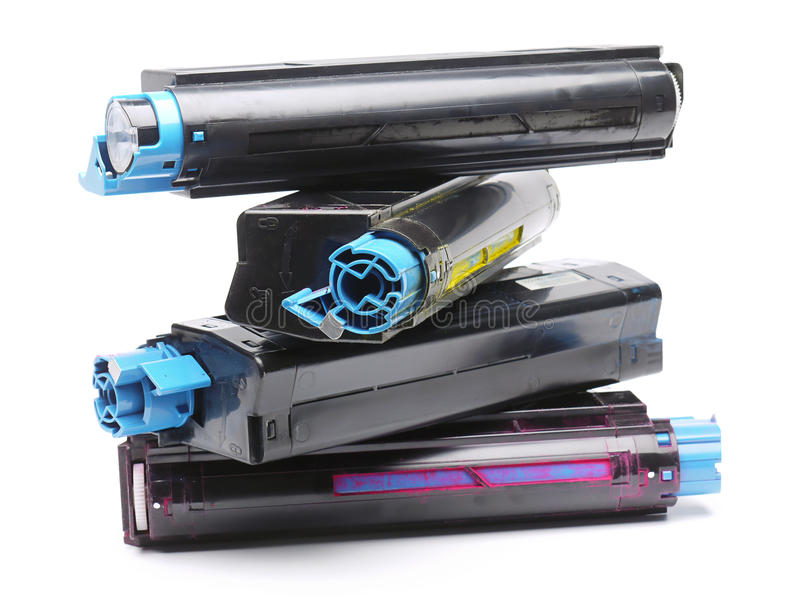 Four color laser printer toner cartridges. Pile of four used laser printer toner cartridges of Cyan, Magenta, Yellow and black color shot over white background royalty free stock photography