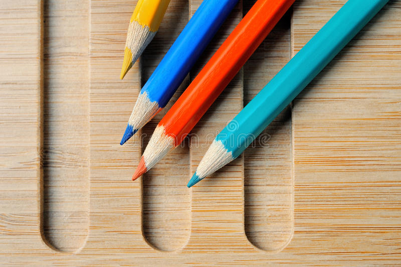 Four Color pencil on wooden background. Color pencil composition still life royalty free stock image