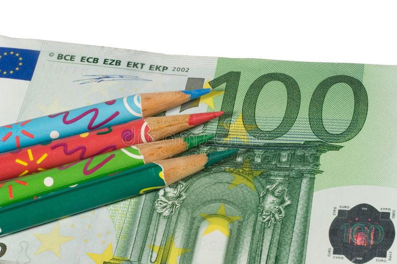 Four color pencils on a euro bill stock images