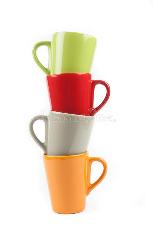 Four color tea cups royalty free stock image