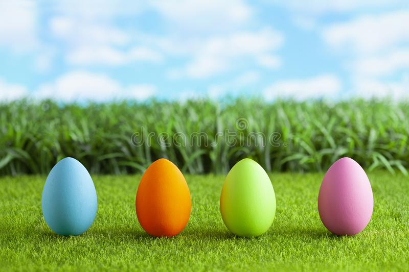 Four colored Easter eggs on grass royalty free stock images