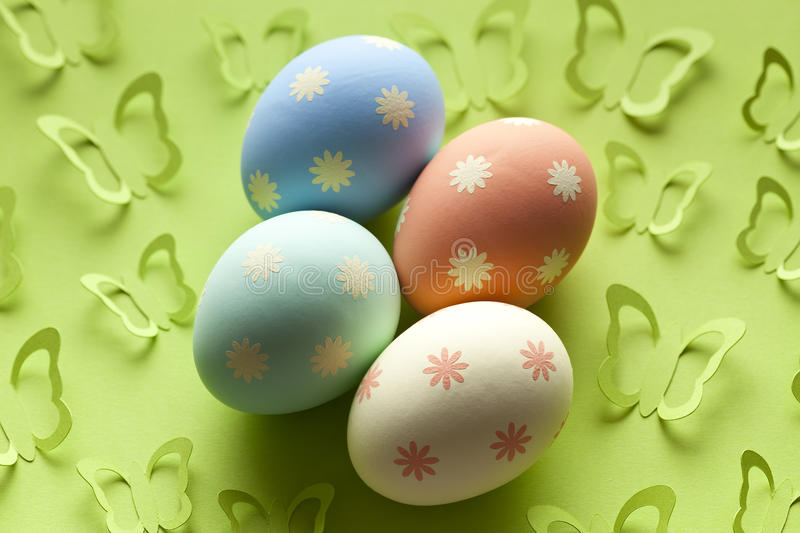 Four colored Easter eggs on green background stock image