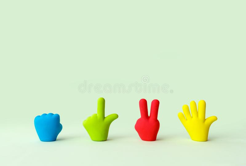 Four colorful cartoon hands set. Symbols of rubber toy hands, is. Four colorful cartoon hands set. Symbols of rubber toy hands, . Fist, victory, open hand. Signs royalty free stock images
