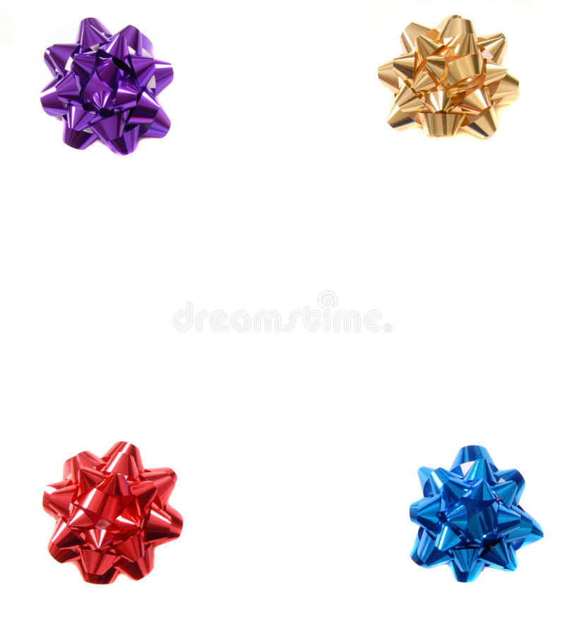 Download Four Colorful Christmas Bows In The Four Corners Of An Isolated Stock Image - Image: 1625917