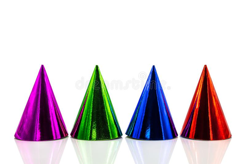 Four colorful party hats with reflections, isolated on white background, Birthday party and silvester royalty free stock image