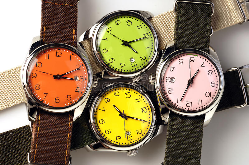 Four colorful watches royalty free stock images