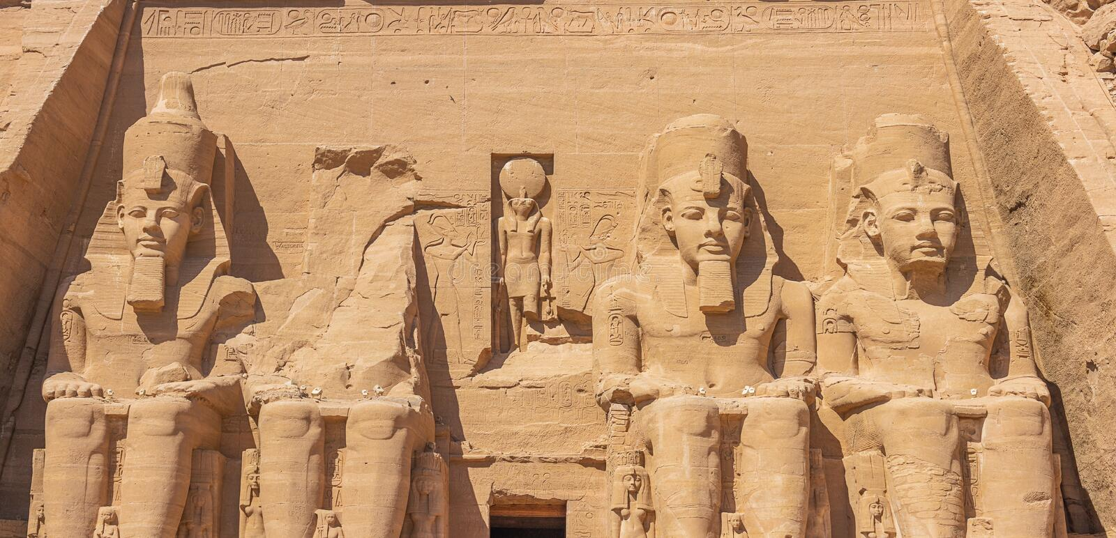 Four colossal statues of Ramesses II aligned. In front of the Great Temple of Abu Simbel stock photos