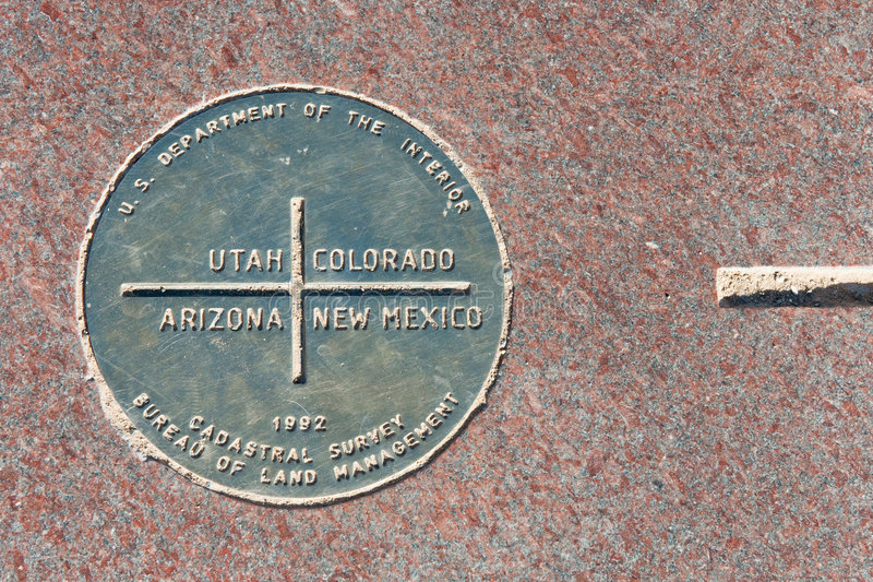 Four Corners Monument. Metal plaque at the Four Corners monument where Utah, Arizona, New Mexico and Colorado meet royalty free stock photos