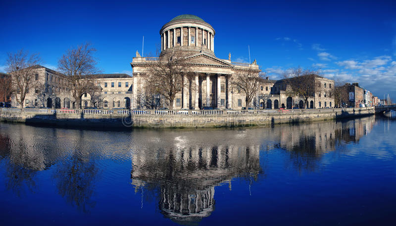 Four Courts in Dublin. Four courts building in Dublin, Ireland with river Liffey royalty free stock photography