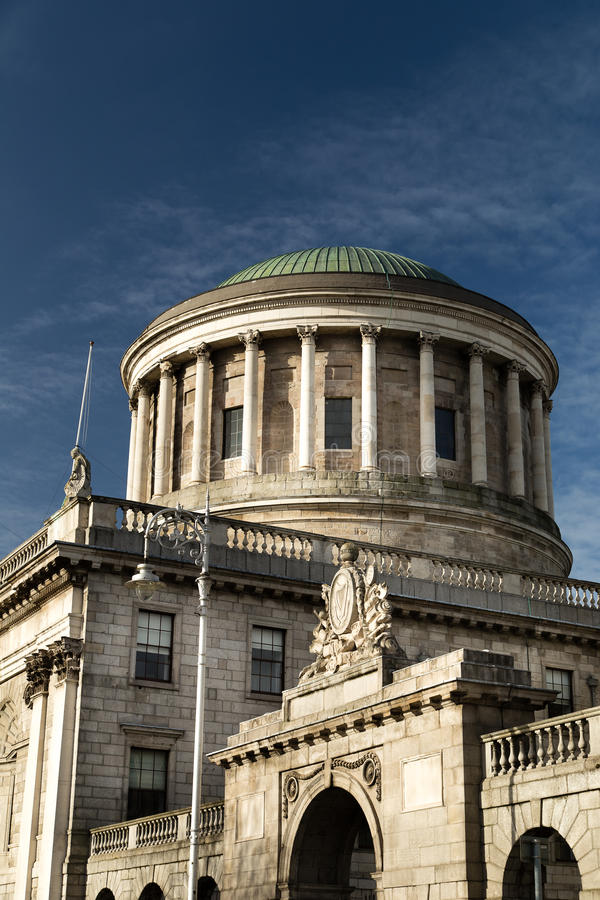 Four Courts and River Liffey. The Four Courts and River Liffey in Dublin in the evening royalty free stock images