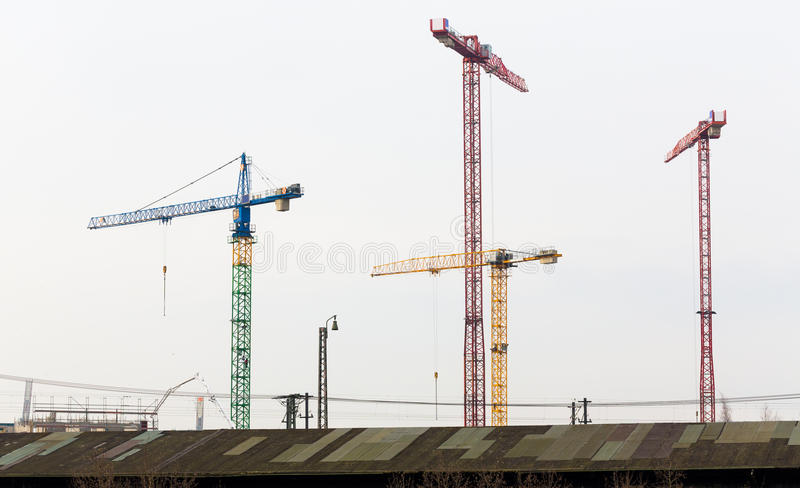 Four cranes on building site in Hamburg. Industrial area. royalty free stock images