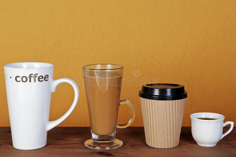 Four cups of coffee. Photo of four types of coffee including a latte, espresso, mocha and cappuccino in different styles of cups, mugs and containers stock images