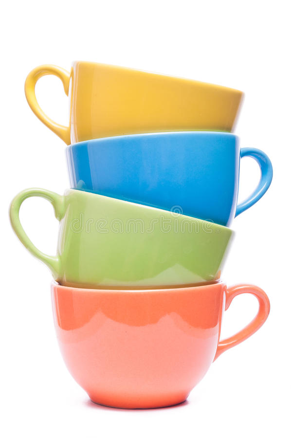 Four cups stacked. Colored mugs. Colorful image with tableware. royalty free stock photo