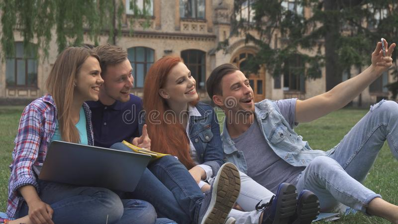 Students take selfie on the lawn royalty free stock photo