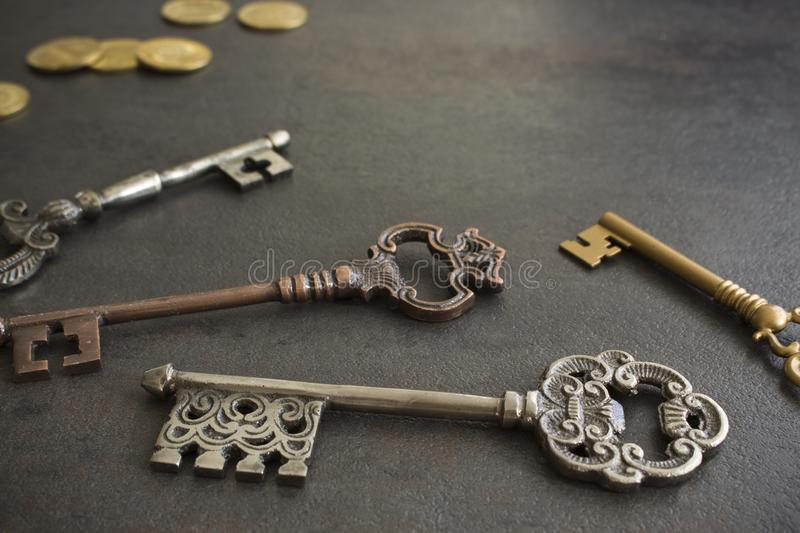 Four Vintage Keys & Coins. Four different antique style vintage keys with coins stock images