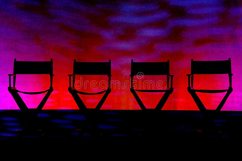 Four Director S Chairs Silhouette On Swirl Stage Stock