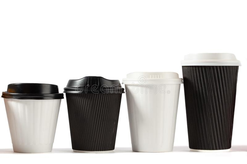 Four disposable coffee cups ascending height. stock image