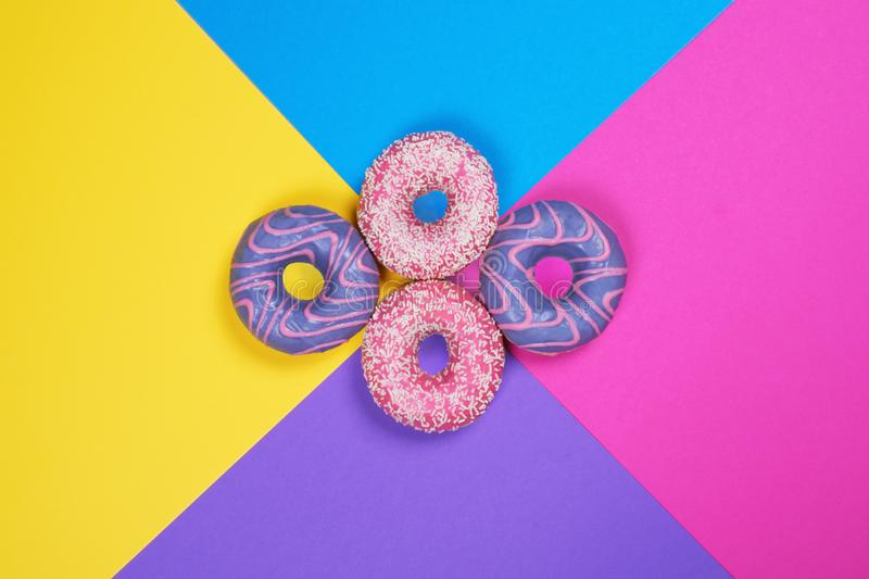 Four donuts on multi colored background stock photography