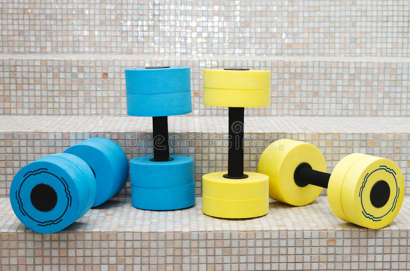 Four dumbbell water aerobics. Four dumbbell weights for water aerobics royalty free stock photo
