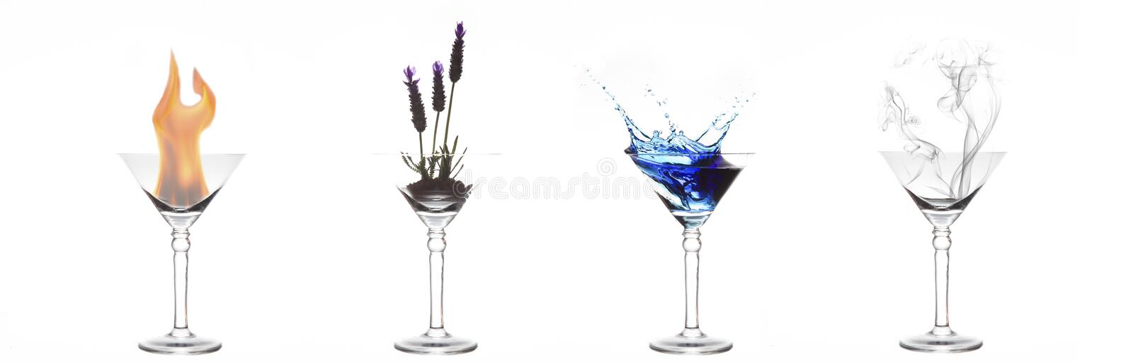 Four elements of fire, plant, water and air in martini glasses royalty free stock photo
