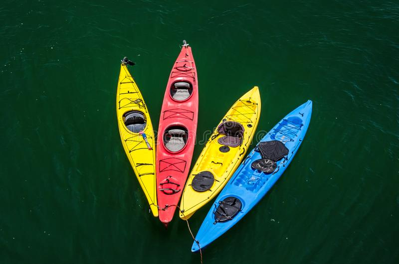 Colorful kayaks in the water stock photography