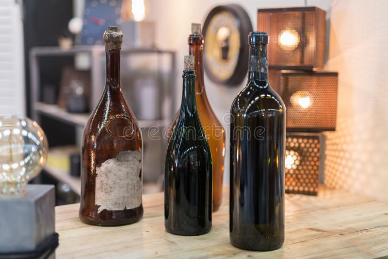 Four Empty Dark Glass Bottles with Corks stock images