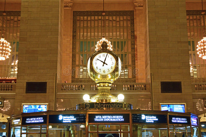 The four faced clock on top of the information booth is one of the most recognizable icon of Grand Central. Train station. The clock, designed by Henry Edward stock photo