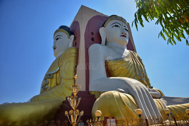 The four faces monks temple in Myanmar. Like a monument, there are four monks sitting back to back in four direction in the front of the Myanmar temple. The stock image