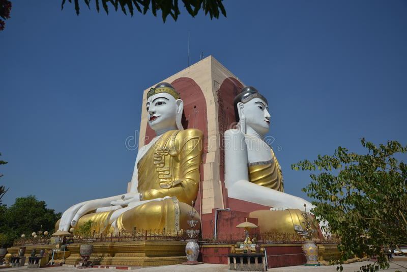 The four faces monks temple in Myanmar. Like a monument, there are four monks sitting back to back in four direction in the front of the Myanmar temple. The royalty free stock photos