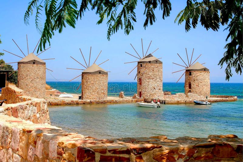 Chios, Greece, the four windmills. The four famous windmills on the isle of Chios, Greece. Special atmosphere against the blue sky and the blue sea stock photo