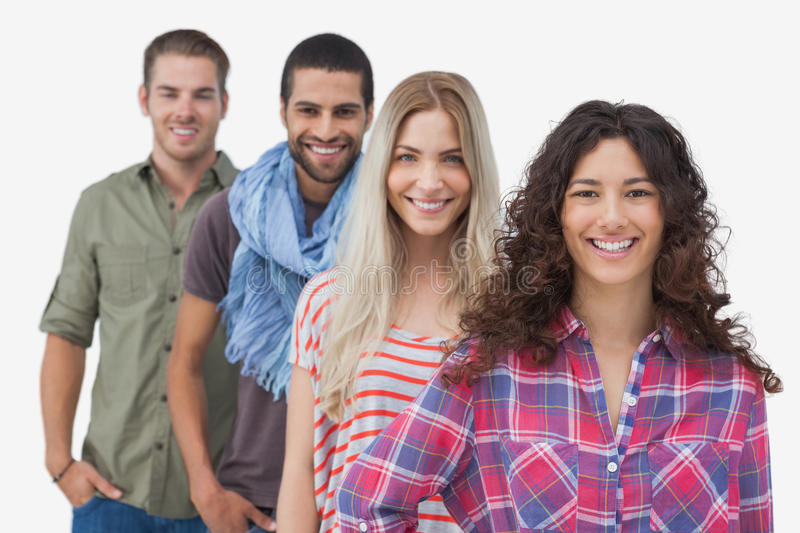 Four fashionable friends looking at camera. On white background royalty free stock photo