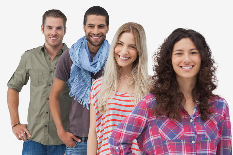 Four fashionable friends smiling at camera stock photo