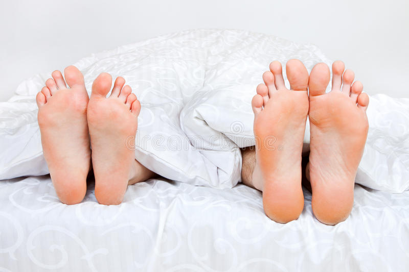 Four Feet In A Bed Stock Images
