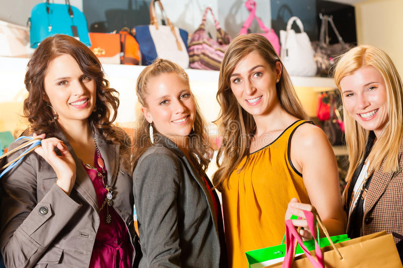 Download Four Female Friends Shopping Bags In A Mall Stock Images - Image: 26486994