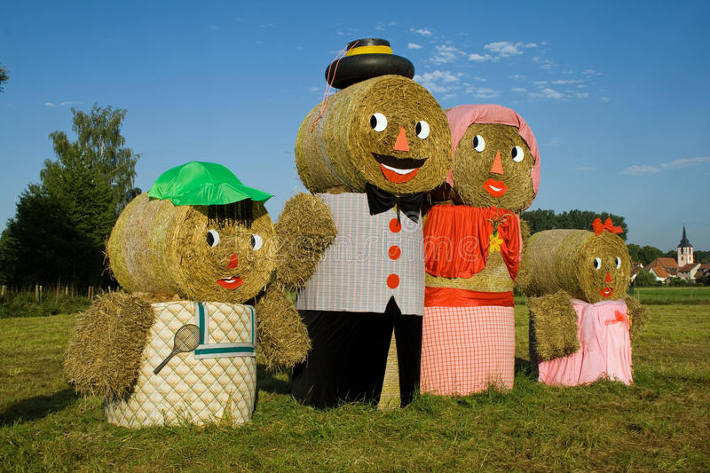 Download Four Figures Made Out Of Straw Bales Royalty Free Stock Images - Image: 22005659