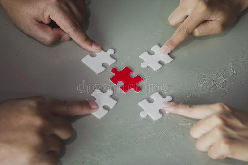 Four finger point holding connecting four white and red piece jigsaw puzzle,Business connection,Success and strategy. Concept,Business accounting,Many persons stock image