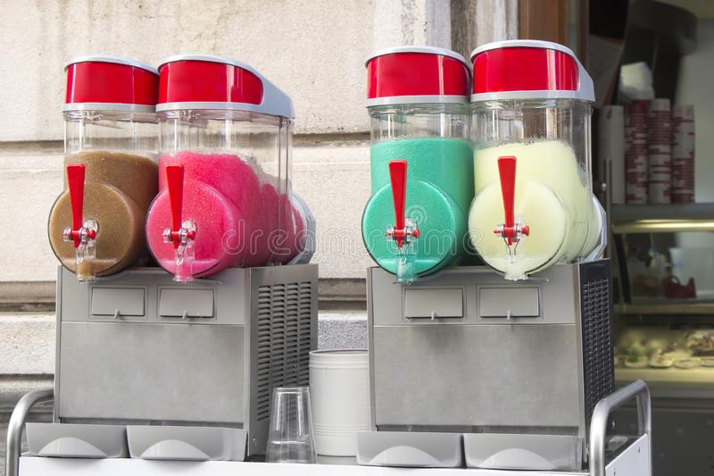 Four flavors of grenadine ice for sale. On the street royalty free stock images