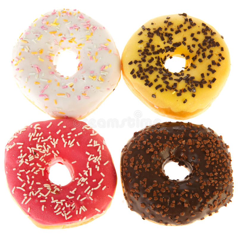 Four fresh donuts. Four assorted fresh donuts in different tastes stock photography
