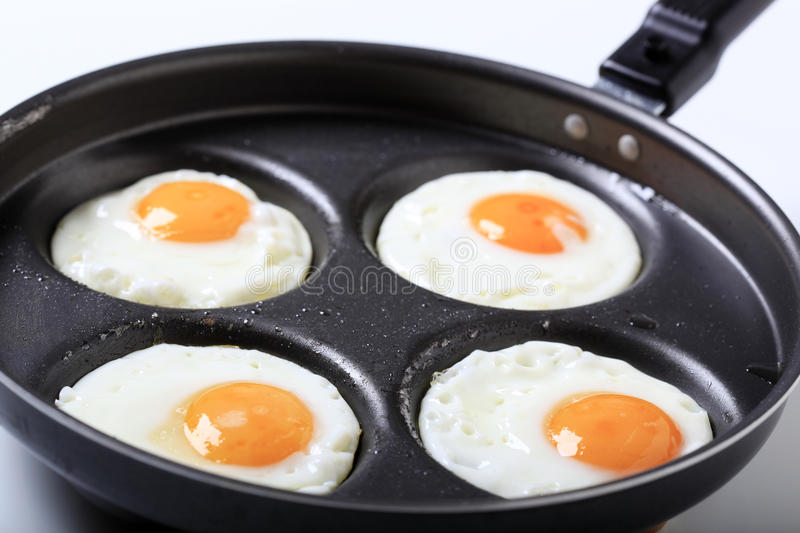 Four fried eggs stock photography