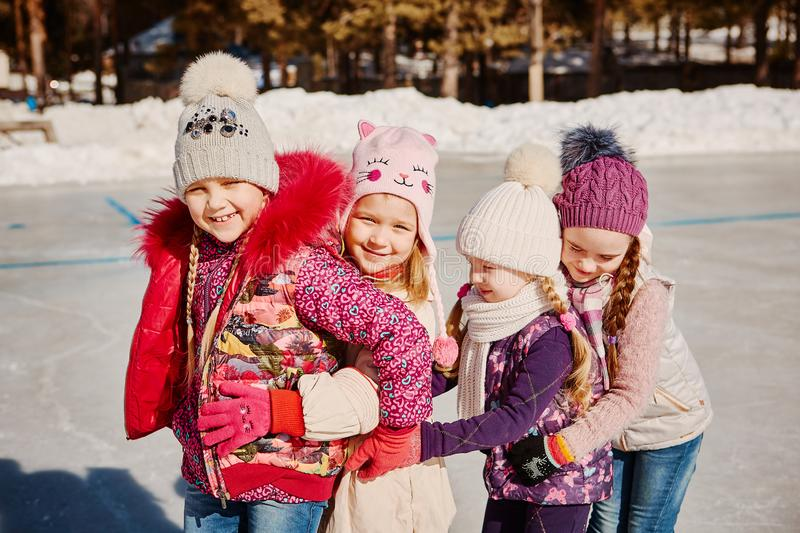 Four friends have fun at the rink royalty free stock photos