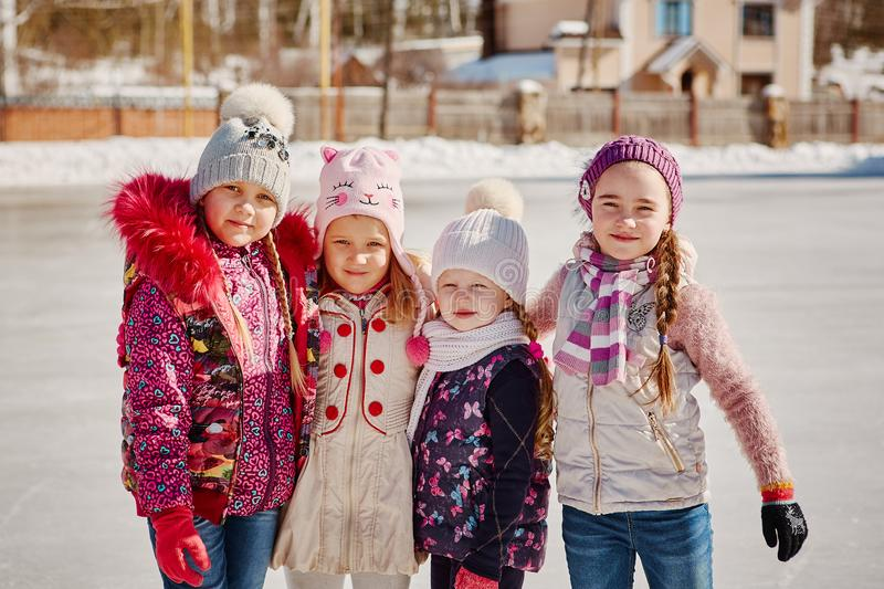 Four friends have fun at the rink royalty free stock image