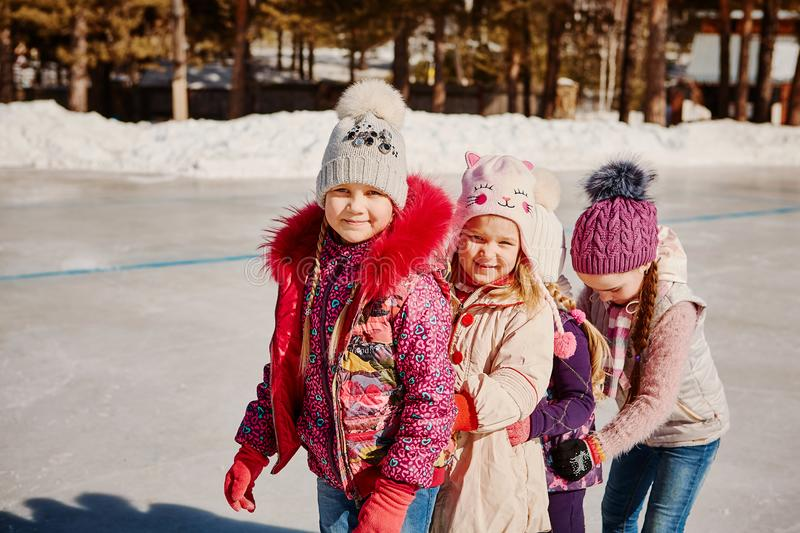 Four friends have fun at the rink stock images