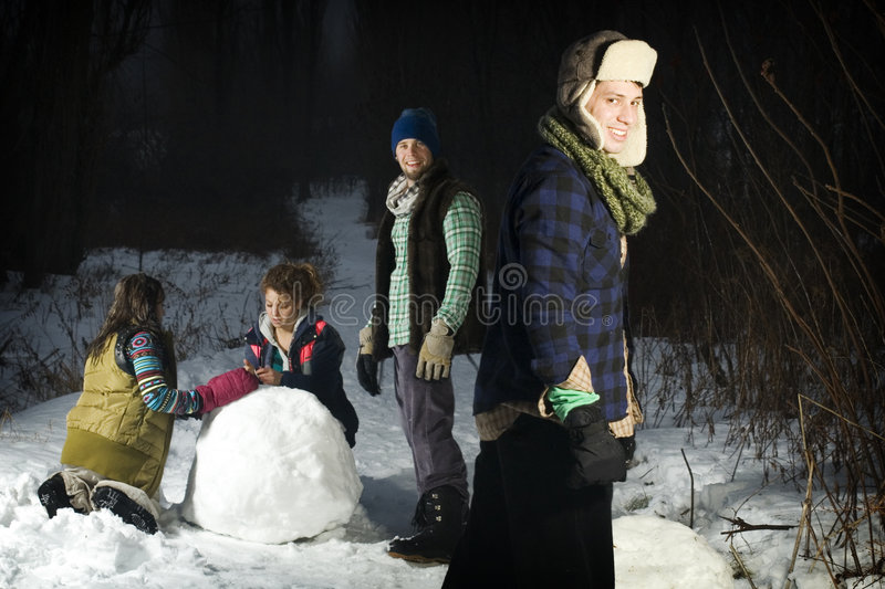 Download Four Friends Making Snowballs In Forest Stock Image - Image: 7919975