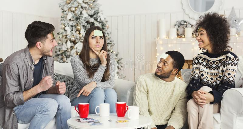 Four friends are playing together who I am stock photography